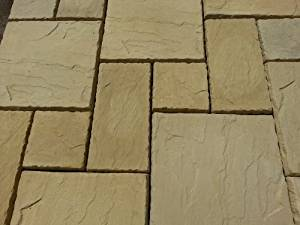 Stone Concrete Random Paving in Cotswold Buff.